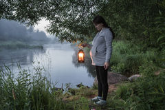 A pregnant girl on the beach night river in the Leningrad region ,Russia Stock Images