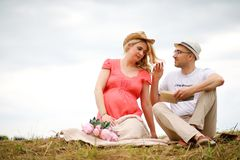 Pregnant girl with big belly and young man outdoor. Pregnant girl with big belly and young men in parkr Stock Photography