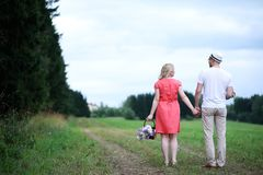 Pregnant girl with big belly and young man outdoor. Pregnant girl with big belly and young men in parkr Royalty Free Stock Photo