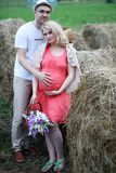 Pregnant girl with big belly and young man outdoor. Pregnant girl with big belly and young men in parkr Stock Images