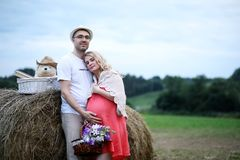 Pregnant girl with big belly and young man outdoor. Pregnant girl with big belly and young men in parkr Royalty Free Stock Images