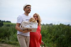 Pregnant girl with big belly and young man outdoor. Pregnant girl with big belly and young men in parkr Stock Photo