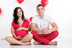 Pregnant girl and boy with red heart shape Royalty Free Stock Photo