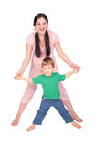 Pregnant girl with child doing exercise Royalty Free Stock Photos