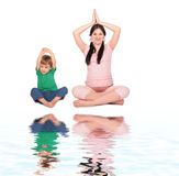Pregnant girl with child doing exercise siting Royalty Free Stock Images