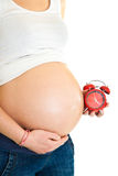 Pregnant girl with clock Royalty Free Stock Photos