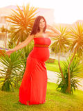 Pregnant girl dancing outdoors Royalty Free Stock Photo