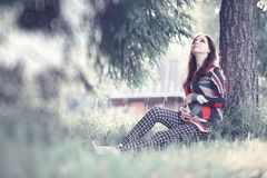 Pregnant girl in a dress in nature. On a walkr stock photos