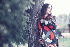 Pregnant girl in a dress in nature. On a walkr royalty free stock images