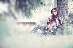 Pregnant girl in a dress in nature. On a walkr royalty free stock photography