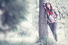 Pregnant girl in a dress in nature. On a walkr royalty free stock image