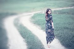 Pregnant girl in a dress in nature. On a walkr royalty free stock photo