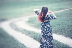Pregnant girl in a dress in nature. On a walkr royalty free stock photos