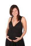 Pregnant girl embraces belly Stock Image