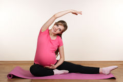 Pregnant girl is engaged in fitness Royalty Free Stock Photo