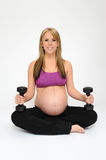 Pregnant Girl Exercising Royalty Free Stock Photos