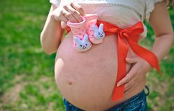 Pregnant girl expectant mother stock images