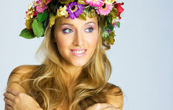 Pregnant girl with flower wreath Stock Photos