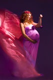 Pregnant girl with flying dress Stock Photo