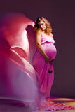 Pregnant girl with flying dress Royalty Free Stock Image