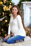 Pregnant girl in front of Christmas trees Royalty Free Stock Photography