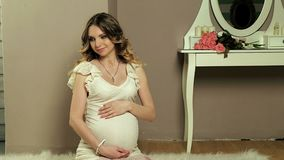Pregnant girl in front stock footage