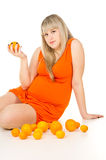 Pregnant girl with fruit Stock Images