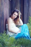 Pregnant girl on the grass Royalty Free Stock Photos