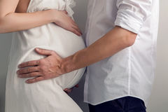 Pregnant girl and her husband standing Stock Photos
