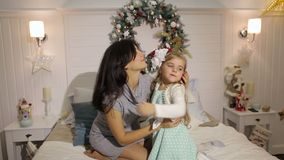 Pregnant hugs her little daughter for Christmas. stock video footage