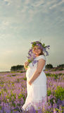 Pregnant girl in lilac colors. Pregnant girl in purple colours at sunset Stock Images