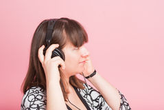 The pregnant girl listens to music Stock Images
