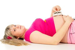 Pregnant girl lying Royalty Free Stock Photos