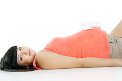 Pregnant girl lying with booties Stock Photo