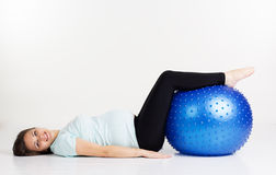 Pregnant girl lying on fitball Stock Photography