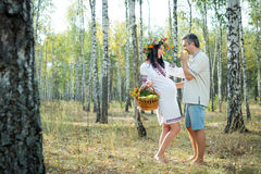 Pregnant girl and man in a birch grove. Stock Photo