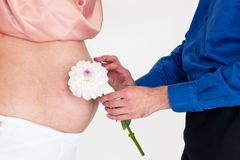 The pregnant girl with man and flower Royalty Free Stock Photos
