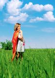 Pregnant girl on the nature. Happy beautiful pregnant woman in nature in summer Stock Photo
