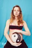 Pregnant girl with a picture Royalty Free Stock Images