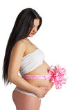 Pregnant girl with pink bow Royalty Free Stock Image