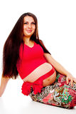 Pregnant girl with a red bow on her stomach Stock Images