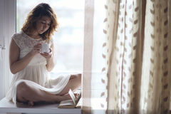Pregnant girl sitting Stock Photography