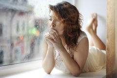 Pregnant girl sitting Stock Images
