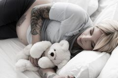 Dreamy woman locating on bed Stock Image