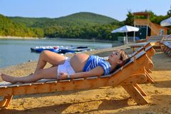 Pregnant Girl Sunbathing By The Beach Stock Image