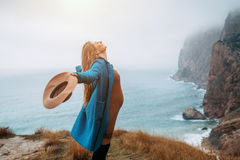 Pregnant girl traveling in mountains, wanderlust. Pregnant girl wearing coat and hat traveling in mountains. Cold weather, calm scene. Happy and healthy Stock Photo
