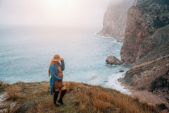 Pregnant girl traveling in mountains, wanderlust Stock Photos