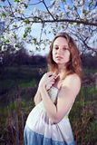 Pregnant girl on a tree Royalty Free Stock Photos