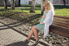 Pregnant Girl Walking Around The City Park In Early Spring Royalty Free Stock Image