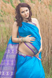 Pregnant girl is wearing fashion blue indian sari Stock Images